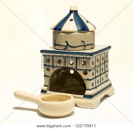 aroma oil burner isolated on white,health,culture,red and..