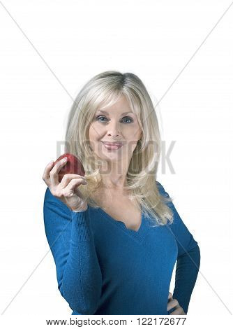 Pretty woman holding apple against white background
