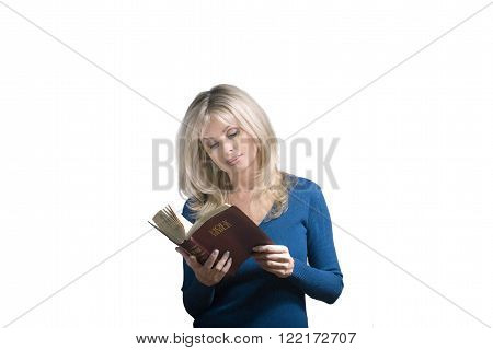 Woman reads a Bible against a white background.