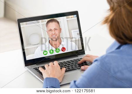 Close-up Of Woman Video Chatting On Laptop