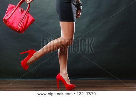 Girl In Black Short Dress Red Spiked Shoes Holds Handbag