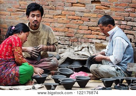 Nepalese People Working In The Pottery Workshop