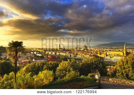 Florence or Firenze sunset aerial cityscape. Panorama view from Michelangelo park square. Ponte Vecchio bridge Palazzo Vecchio and Duomo Cathedral. Tuscany Italy