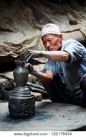 Nepalese  Potter Working In The His Pottery Workshop