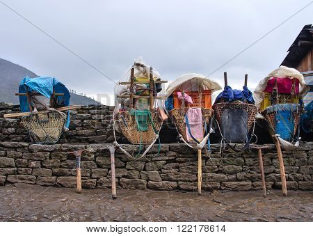 Heavy loads of porters in the Himalaya Mountains Nepal