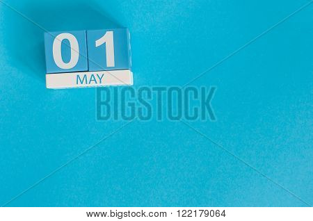 May 1St. Image Of May 1 Wooden Color Calendar On Blue Background.  Spring Day, Empty Space For Text.