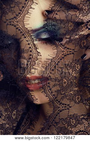 portrait of beauty young woman through lace close up mystery makeup, stylish fashion lady