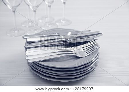Prepared clean dishes for dinner party on a table, close up