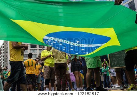Sao Paulo Brazil March 13 2016: One unidentified group of people in the biggest protest against federal government corruption in Sao Paulo.