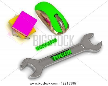 TOUCH bright volume letter on silver instrument textbooks and computer mouse on white background
