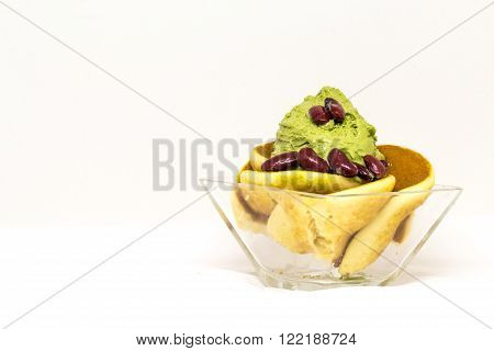 green tea icecream enrich with pancake in glass cup on isolate white backgroud