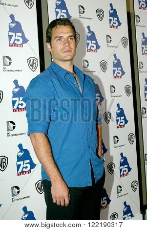 Henry Cavill arrives at the DC Entertainment and Warner Bros.Superman 75th anniversary party during San Diego Comic-Con at the Hard Rock Hotel San Diego's Float Bar on July 19, 2013 in San Diego, CA.