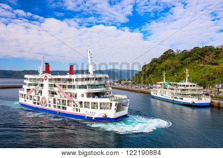 KAGOSHIMA, JAPAN - DECEMBER 12, 2015: The Sakurajima Ferry providing service between the city of Kagoshima and the volcanic island of Sakurajima.