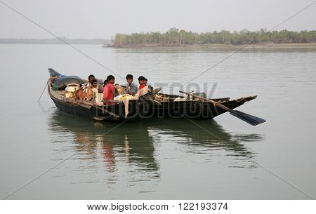 SUNDARBANS, INDIA - JANUARY 15: Traditional fishing boat in the delta of the Ganges River in Sundarbans Jungle National Park in India, on January 15, 2009 in Sundarbans, India.