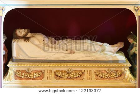 STITAR, CROATIA - AUGUST 27: Jesus Christ in the tomb, church of Saint Matthew in Stitar, Croatia on August 27, 2015