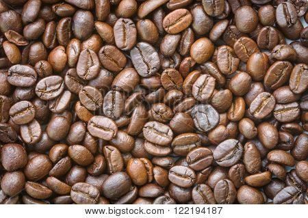 closeup dried coffee beans texture used for background