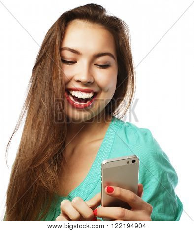 People, lifestyle and tehnology concept: pretty teen girl wearing green shirt, taking selfies with her smart phone -  isolated on white