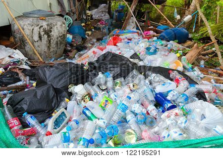 KO MOOK ISLAND, THAILAND, JANUARY 07, 2016 : Heap of soda and water plastic bottle, stored before burning or recycling, Ko Mook island, Thailand