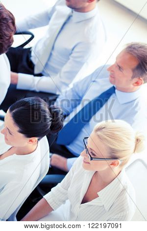picture of smiling businessmen and businesswomen on conference