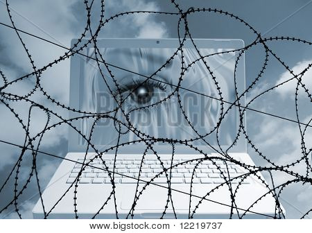 Security concept showing razor wire over eye on laptop