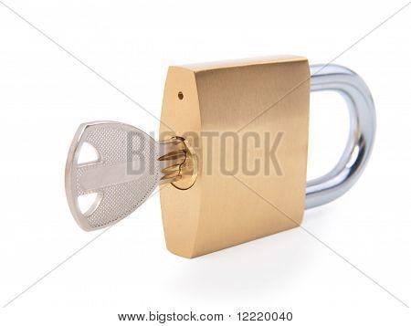 Golden Closed Padlock With Key