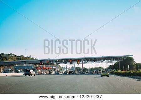 Frejus, France - June 28, 2015: Cars passing through the point of toll highway, toll station