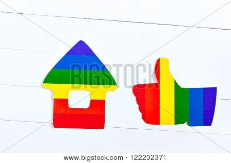 The image of the home and family. Like gesture, thumbs up. Flag Colors of homosexuality. relationship between two people. Same-sex love. Homosexual relationships. Minorities. Logo LGBT.