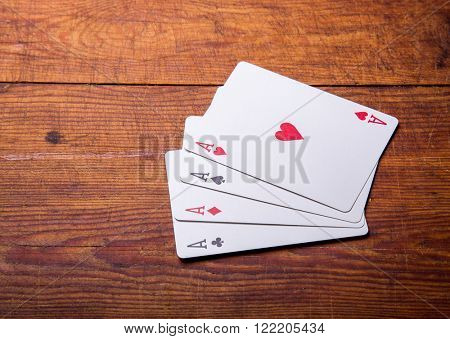 Group of four playing card aces