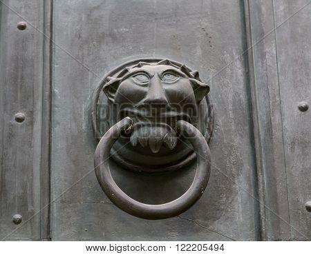 Ornate metal monster head door knocker
