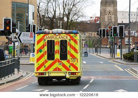 Speeding ambulance in city street responding to emergency call