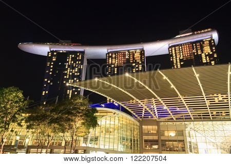 Singapore, Singapore - May 18, 2015: The Shoppes at Marina Bay Sands at night. The hotel is not only a luxury resort famous for its infinity swimming pool, but also a shopping center.