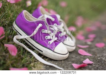 outdoor portrait of a little girl sneakers shoes