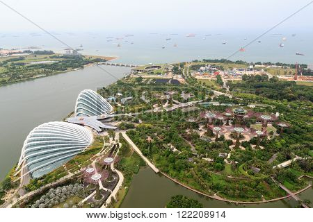 Singapore, Singapore - May 22, 2015: Gardens by the Bay with supertrees and greenhouses. Supertrees are tree-like structures that dominate the Gardens landscape. The conservatories are very energy efficient.