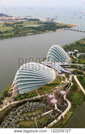 Singapore, Singapore - May 22, 2015: Conservatories at Gardens by the Bay in Singapore. One of the conservatories is called Flower Dome and the other is Cloud Forest. Both are very energy efficient.