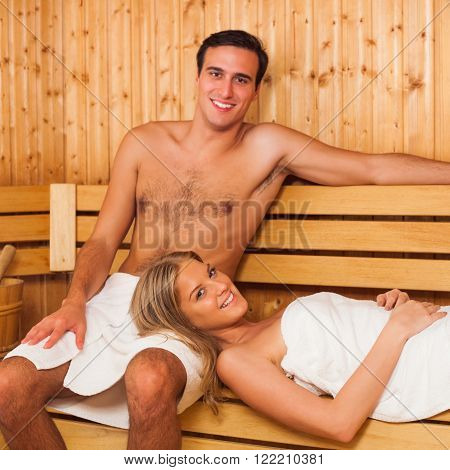 Young happy couple enjoying a sauna together