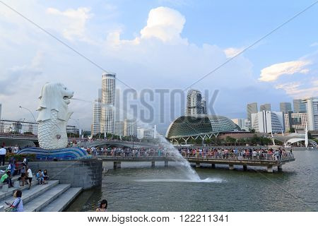 Singapore, Singapore - May 17, 2015: The Merlion statue at the Marina bay with the Skyline in the background. The Merlion is a traditional creature with a lions head and a body of fish. The statue is one of the landmarks in Singapore.