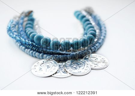 Multilayer bracelet turquoise jewelry on a white background ** Note: Shallow depth of field