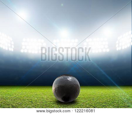 A Shotput Ball In Generic Floodlit Stadium