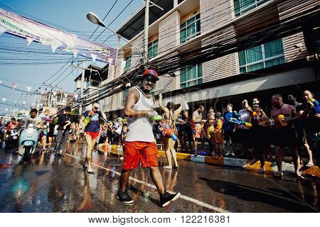 KO SAMUI, THAILAND - APRIL 13:  Unidentified walking man on Songkran Festival (Thai New Year) on April 13, 2014 in Chaweng Main Road, Ko Samui island, Thailand.