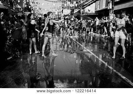 KO SAMUI, THAILAND - APRIL 13:  Unidentified people at the celebration of the water fight festival or Songkran Festival (Thai New Year) on April 13, 2014 in Chaweng Main Road, Ko Samui island, Thailand.