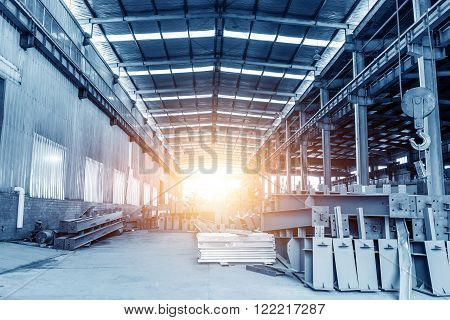 Large steel plants clean shop and neatly stacked steel.
