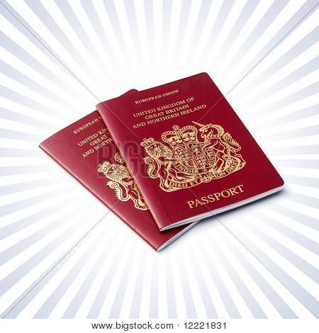 Two British passports over a stripe background
