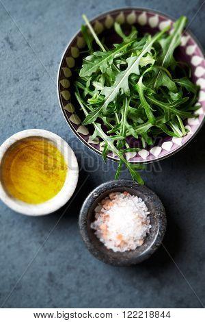 Fresh arugula, flax oil and himalayan salt for salad
