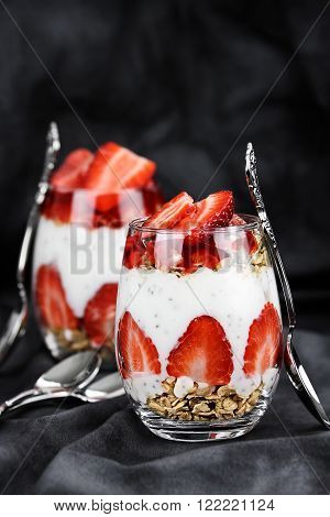 Chai seed parfait made with fresh strawberries. Selective focus with extreme shallow depth of field.