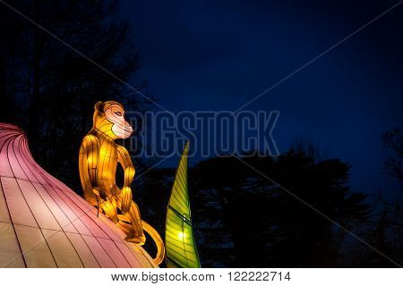London United Kingdom - February 07 2016: Magical Lantern Festival at Chiswick House And Gardens. Monkey sitting on a lotus flower represents New lunar year of Monkey.
