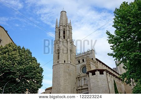 Bell tower of Basilica de Sant Feliu (Collegiate Church of Sant Felix) in evening light in Girona, Catalonia, Spain.