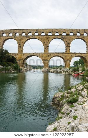 Pont du Gard, in Provence, France, over the Gardon river, is an 160 foot high roman aqueduct built to provide water to the city of Nimes from the river Eure near Uzes, in the first century A.D.
