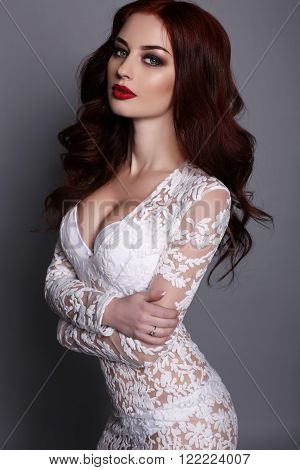 Gorgeous Young Woman With Dark Hair And Evening Makeup, Wears Luxurious Dress