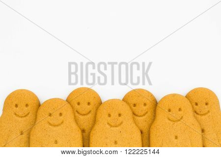 A row of happy, smiling gingerbread men on an isolated white background.