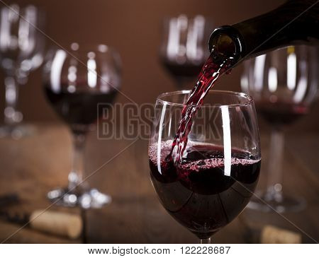 Bottle Filling The Glass Of Wine
